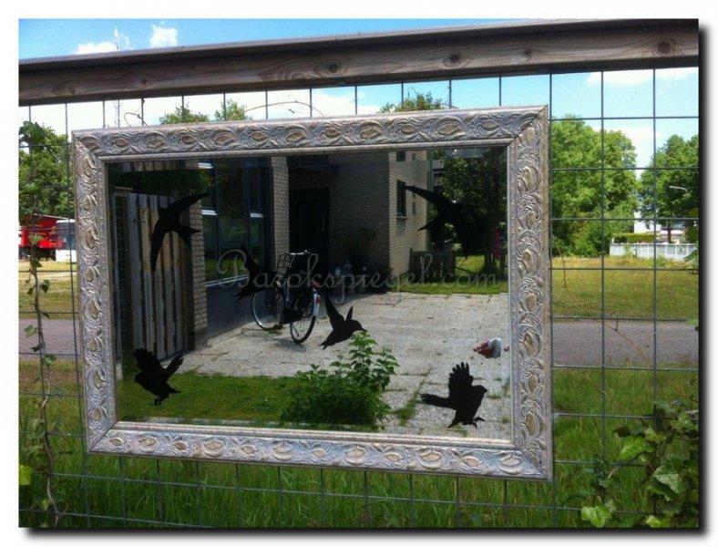 spiegels ter decoratie in de tuin waar moet u op letten